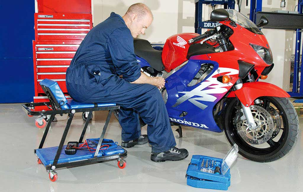 motorcycle creeper seat garage workshop 1024x650 - Basic Motorcycle Maintenance Checklist and Tools
