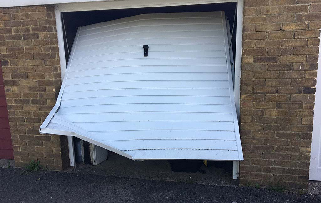 ripped ip garage door 1024x650 - The Best Garage Door Defenders